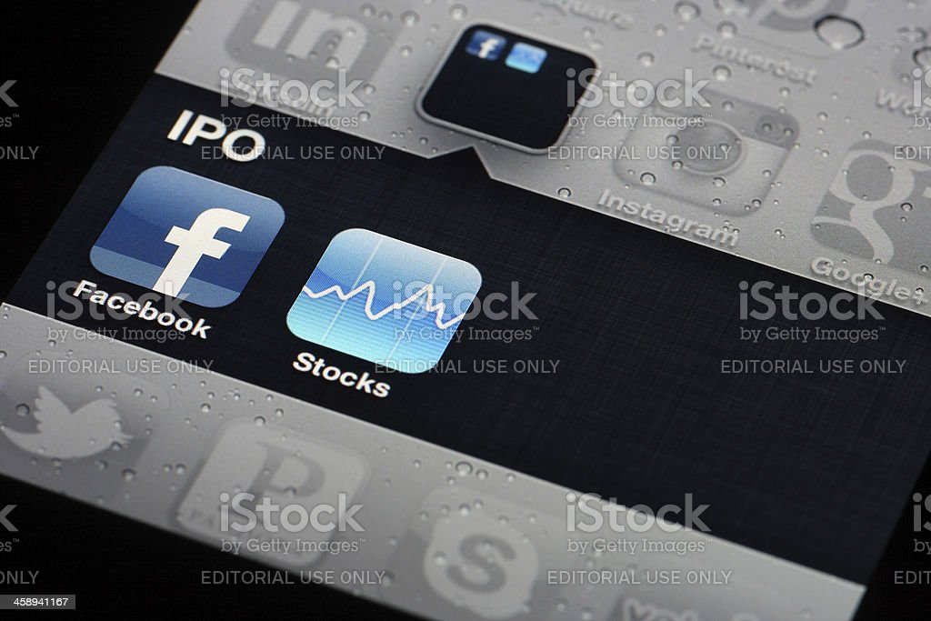 Facebook and Stocks Apps - iPhone 4 stock photo