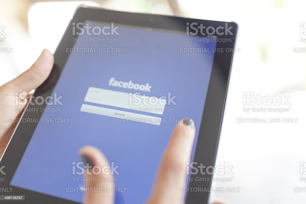 Facebook App for Apple Ipad 3 . Log in royalty-free stock photo