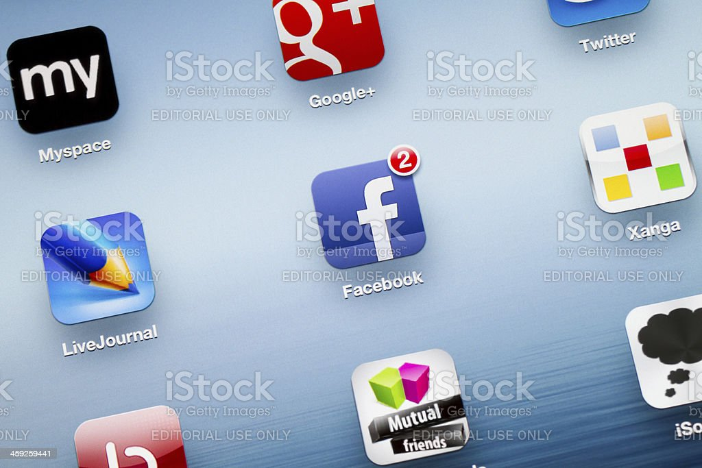 Facebook App icon on New iPad stock photo
