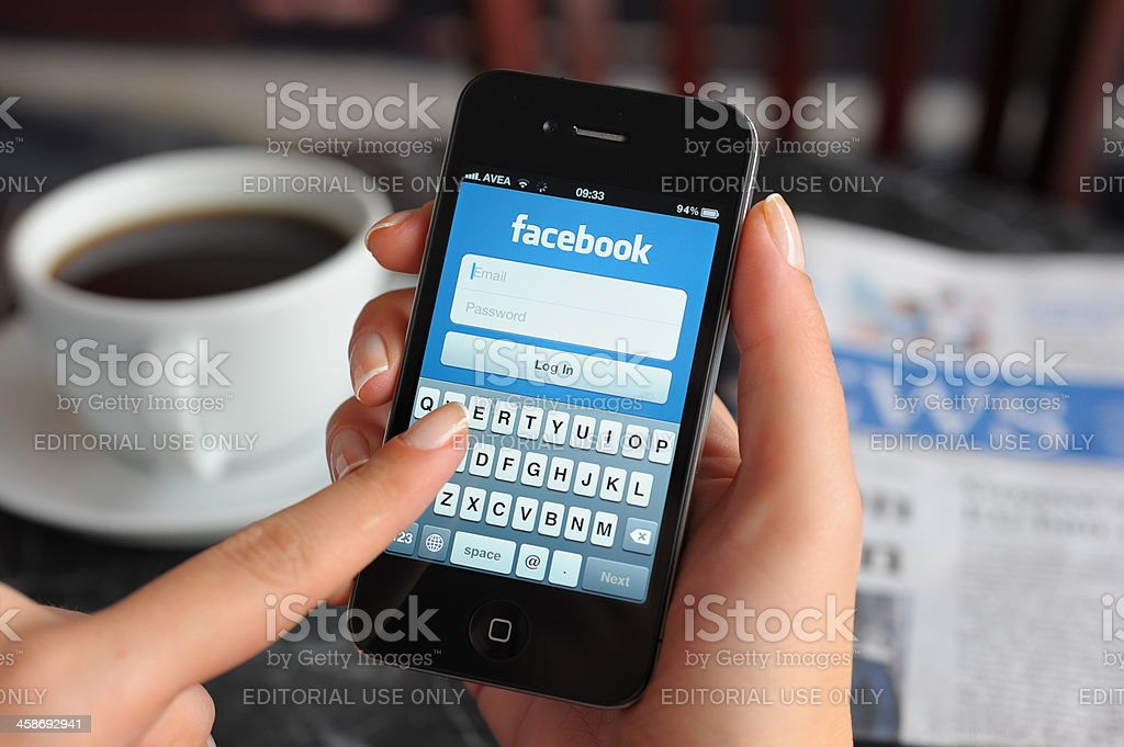 Facebook app on Apple iPhone 4 royalty-free stock photo