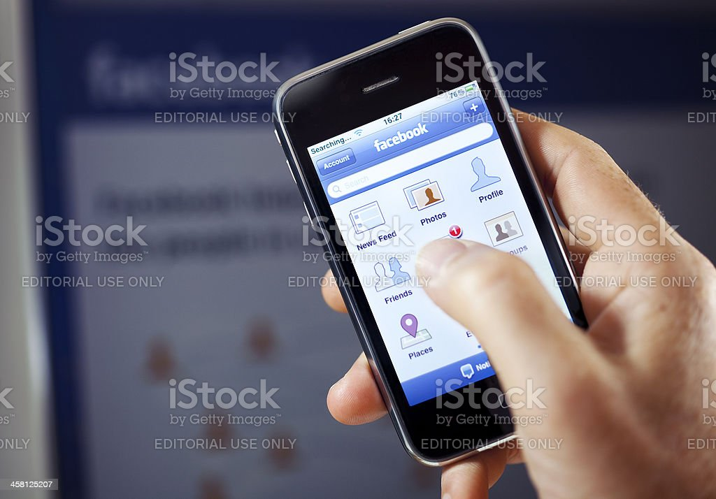 Facebook App on Apple iPhone royalty-free stock photo