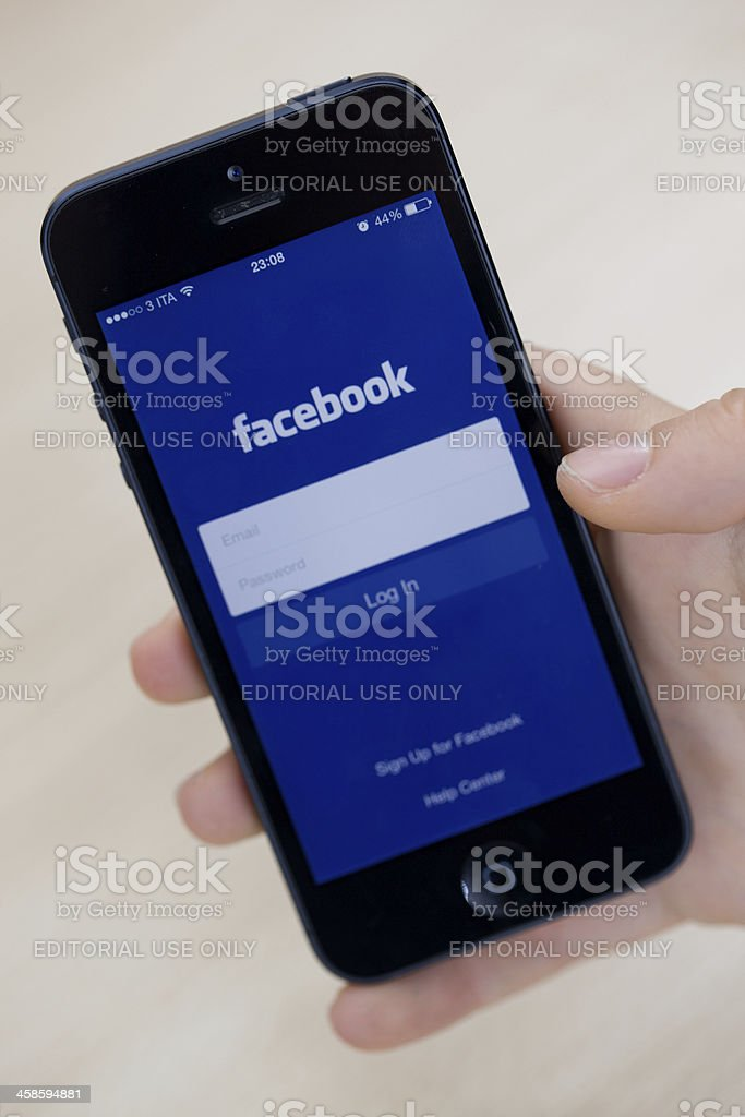 Facebook application on Apple iPhone5 with iOS 7 software royalty-free stock photo