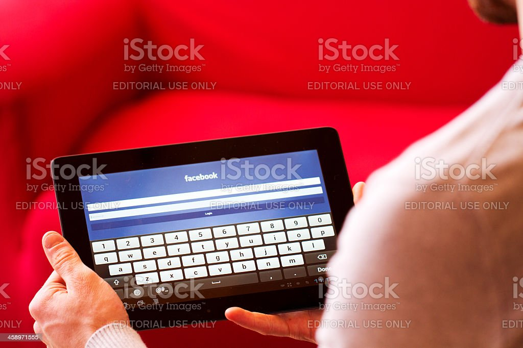 Facebook homepage displayed on an tablet. stock photo