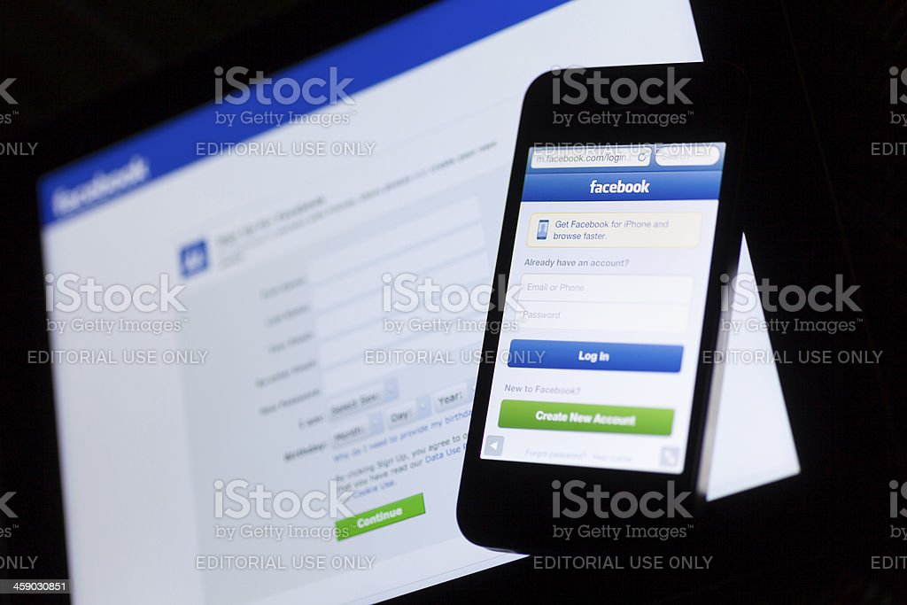 Facebook login webpage on the tablet and phone royalty-free stock photo