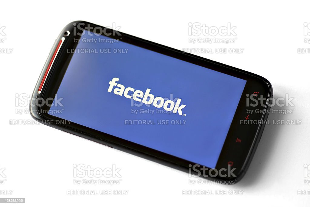 Facebook logo on a smartphone screen royalty-free stock photo