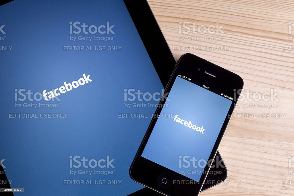 Facebook on Apple iPad & iPhone royalty-free stock photo