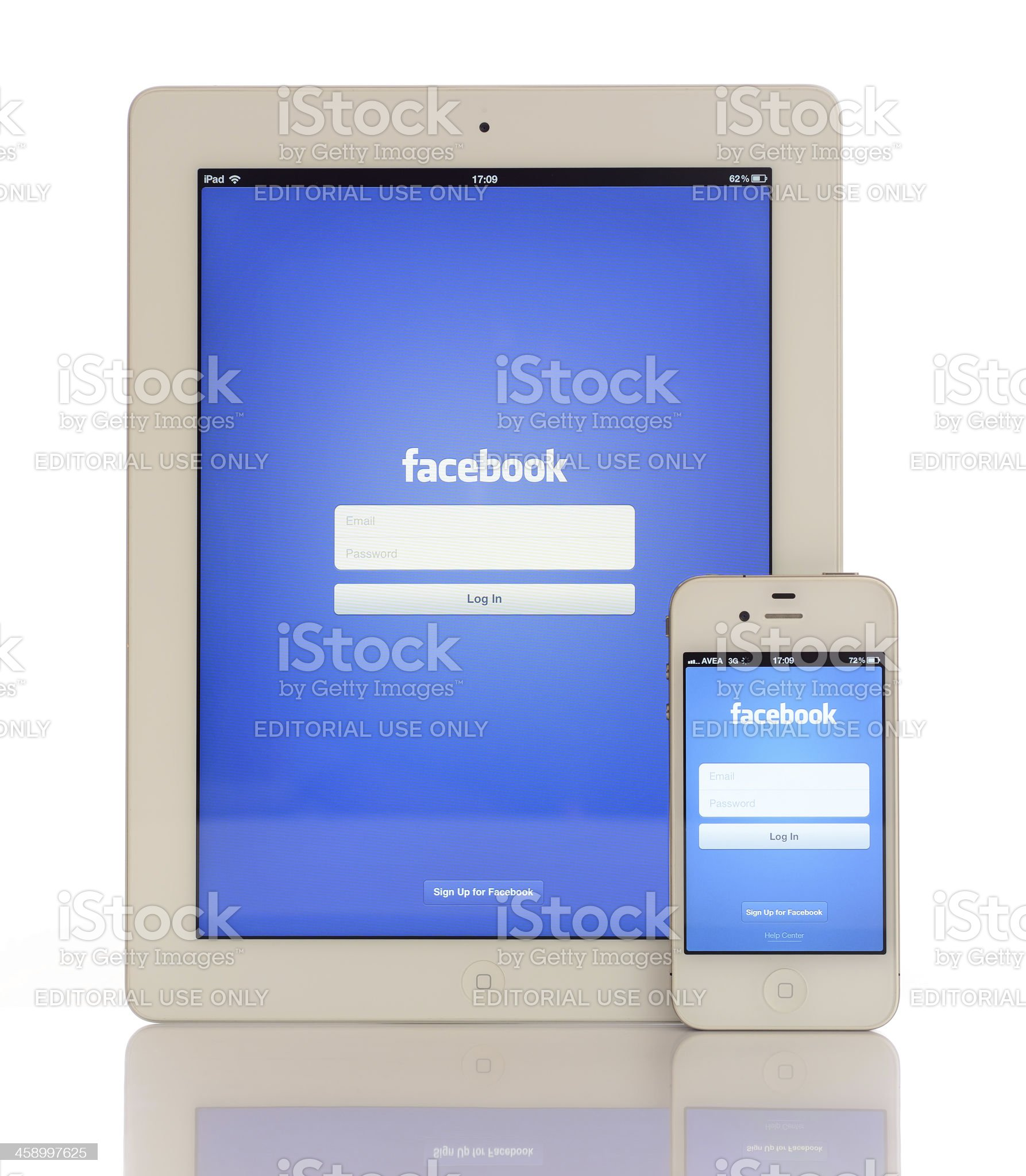 Facebook on iPad 3 & iPhone 4 royalty-free stock photo