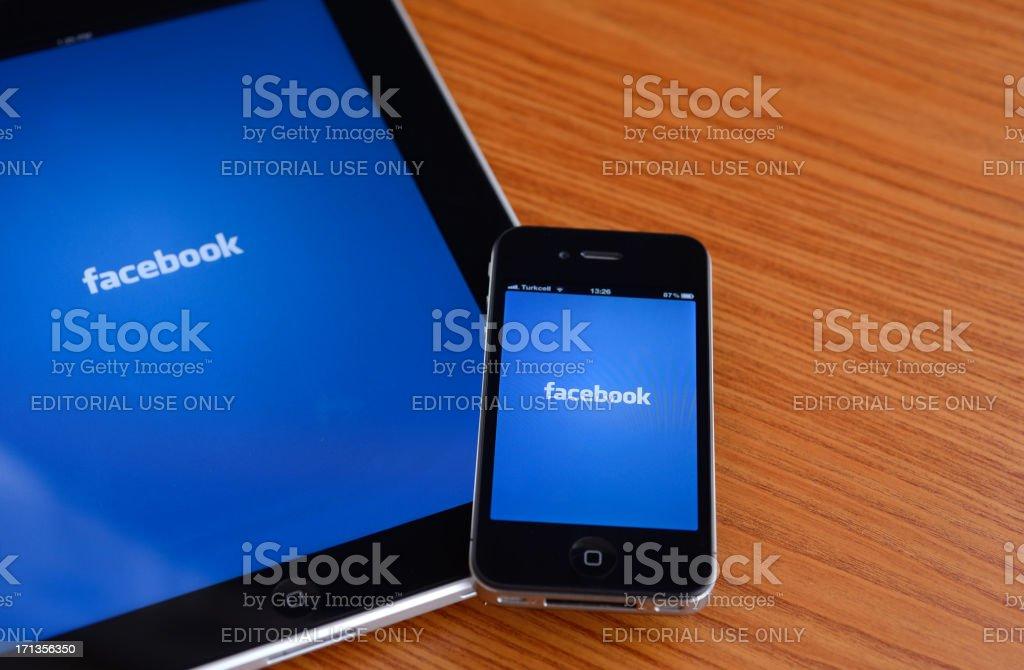Facebook on iPad & iPhone royalty-free stock photo