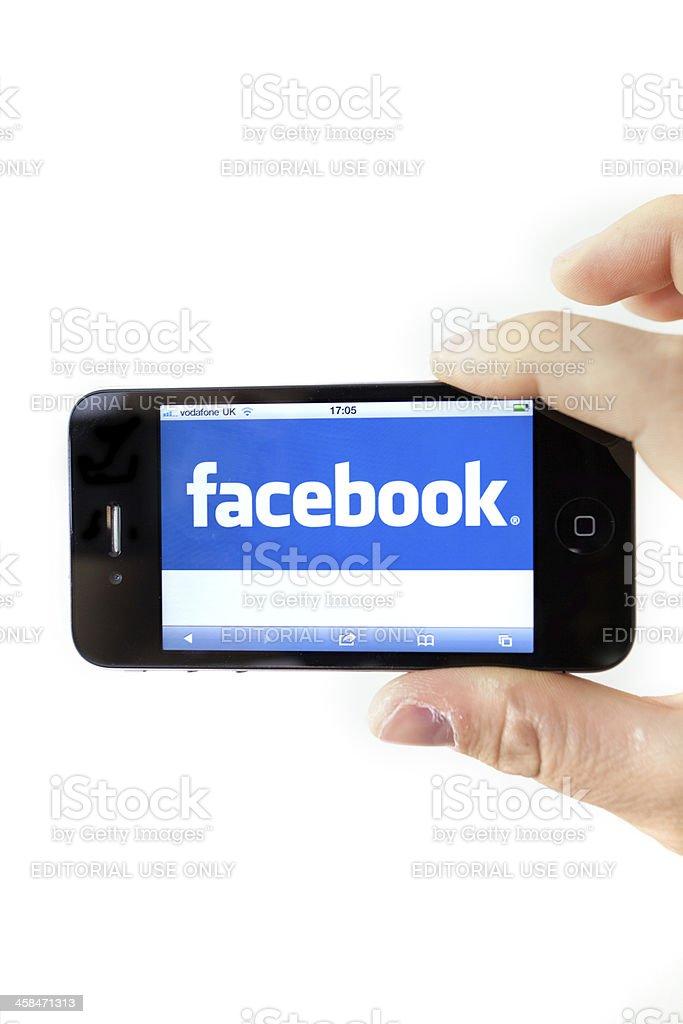 Facebook on Iphone 4 stock photo