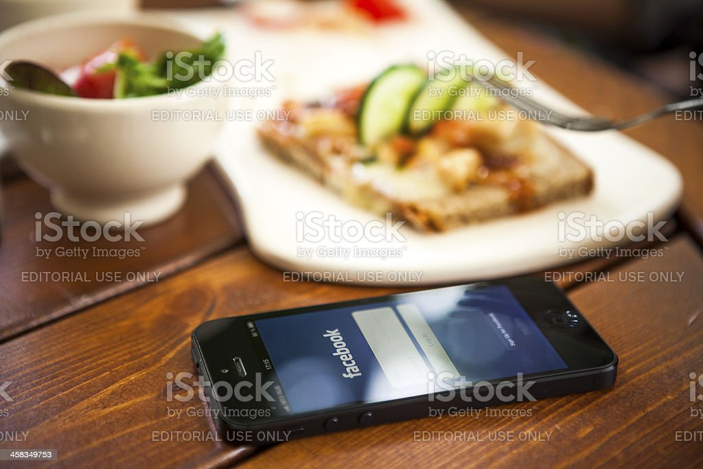 Facebook on iPhone 5 royalty-free stock photo