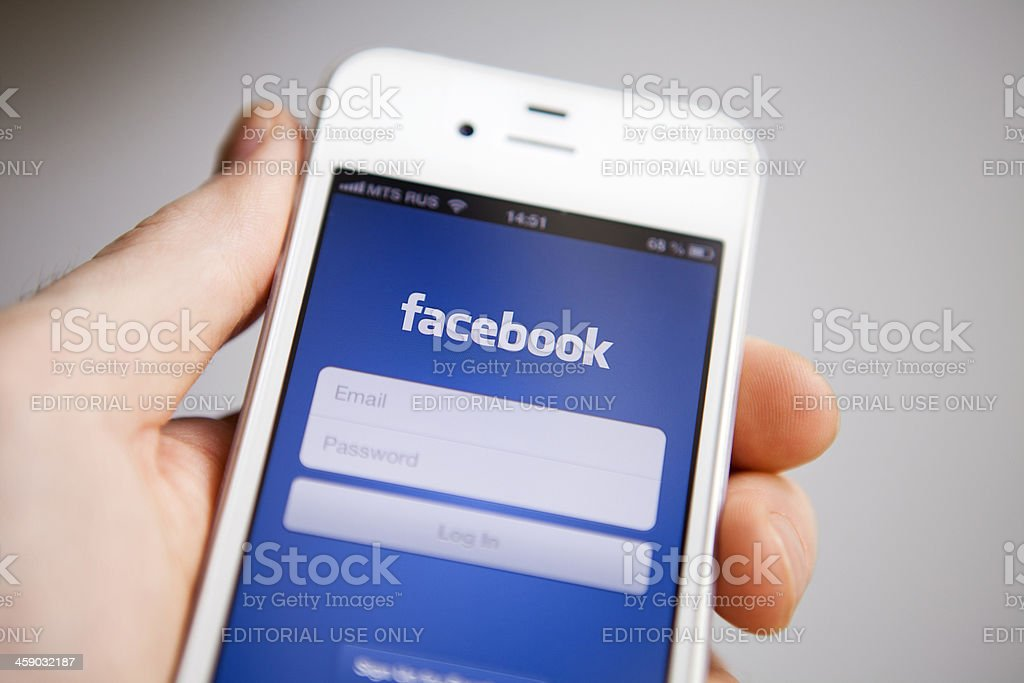 Facebook on iPhone royalty-free stock photo
