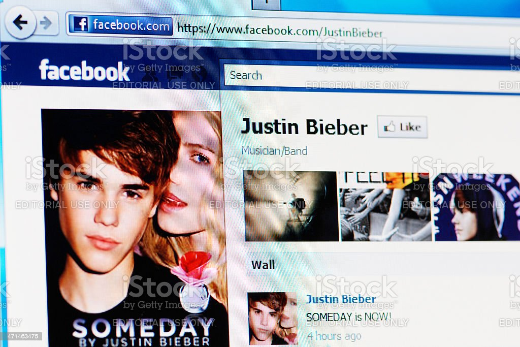 Facebook page of Justin Bieber on RGB laptop monitor stock photo