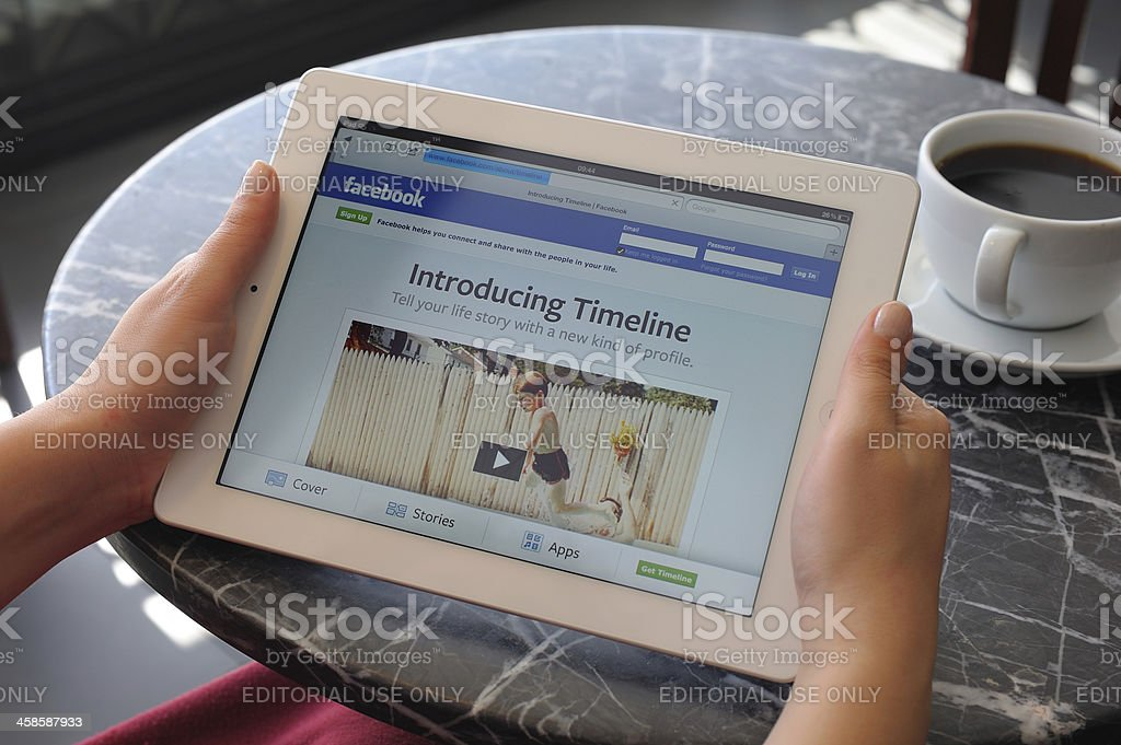 Facebook Timeline on iPad 3 stock photo