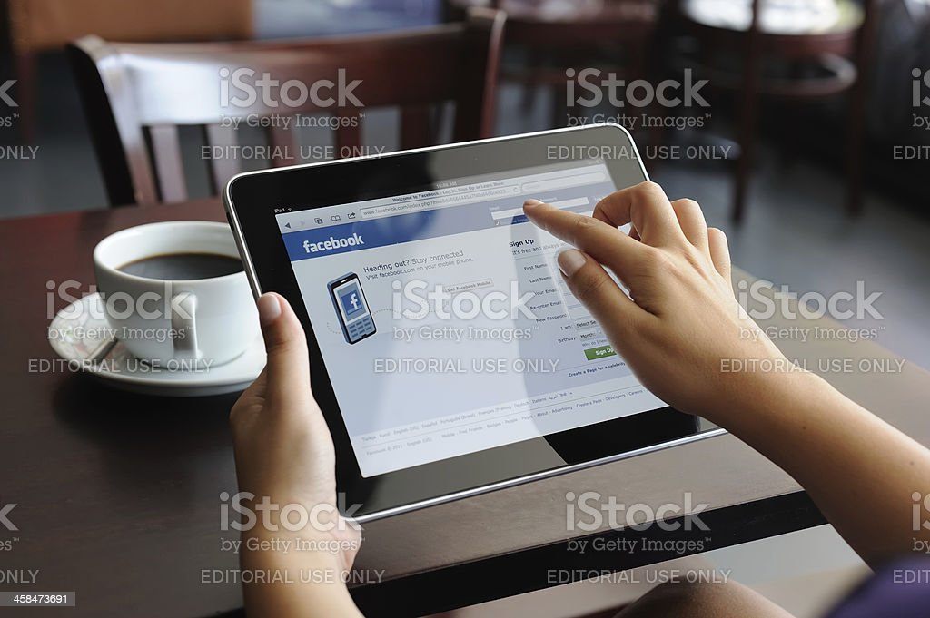 Facebook web page on iPad Apple Digital Tablet royalty-free stock photo