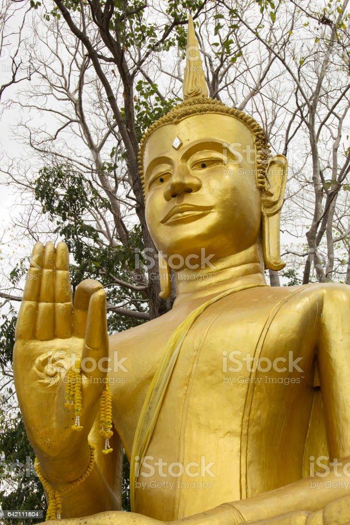 Face,head,hand,Golden Image of Buddha. stock photo