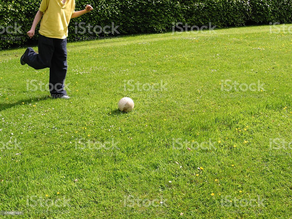 Faceless boy taking soccer kick royalty-free stock photo