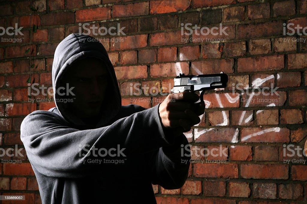 Faceless Gun Toting Hoodlum stock photo