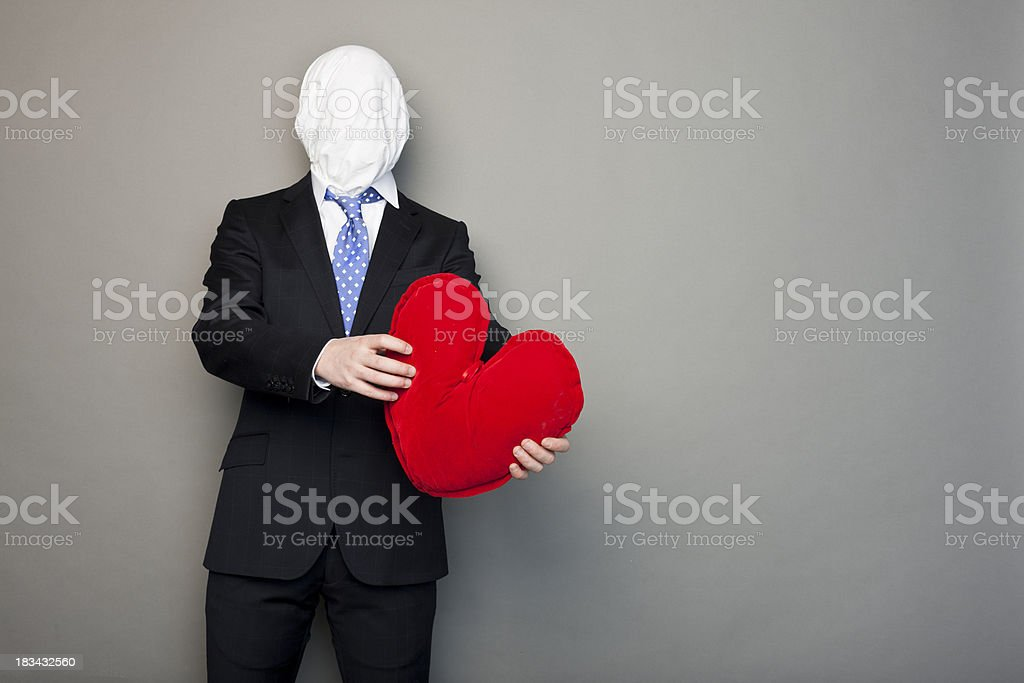 faceless man playing with a heart royalty-free stock photo