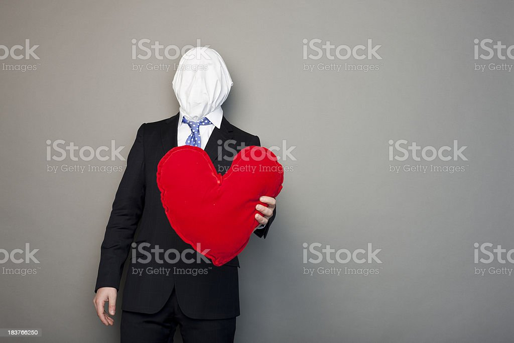 faceless man playing with a heart stock photo