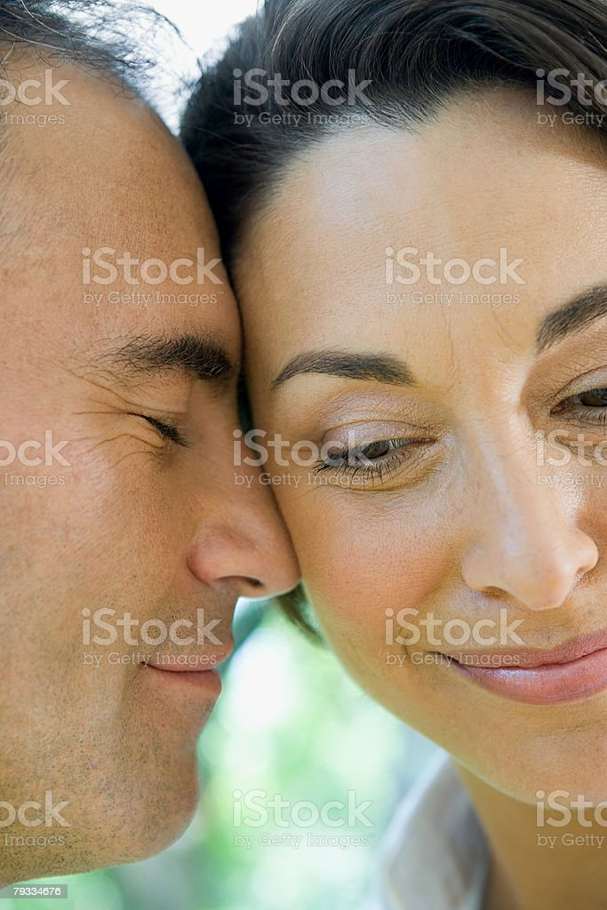 Faces of a loving couple stock photo