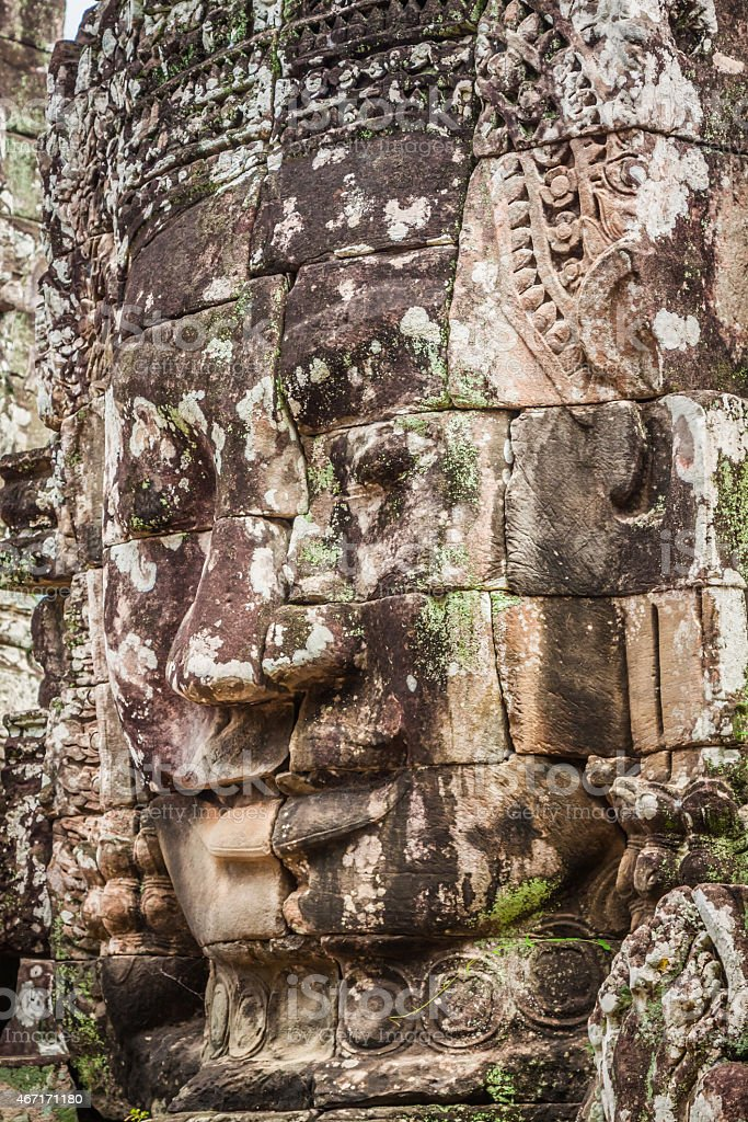 Faces of ancient Bayon Temple At Angkor Wat, Siem Reap stock photo