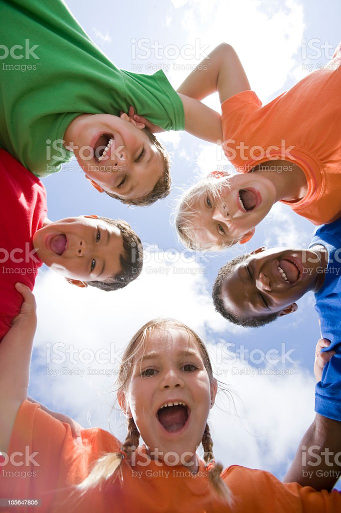 Faces of happy diverse young children in huddle royalty-free stock photo