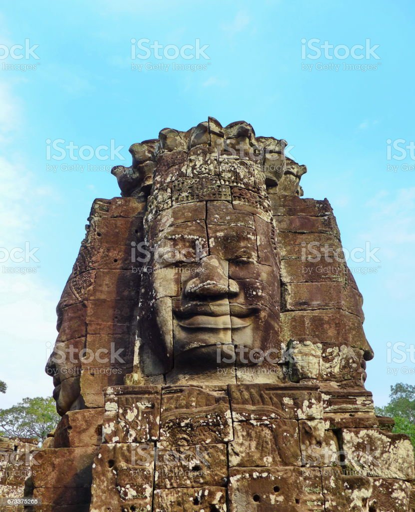 Faces of the Bayon temple in the Angkor Wat complex stock photo