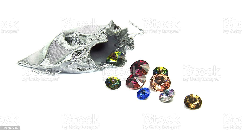 Faceted crystals spilling from a pouch royalty-free stock photo