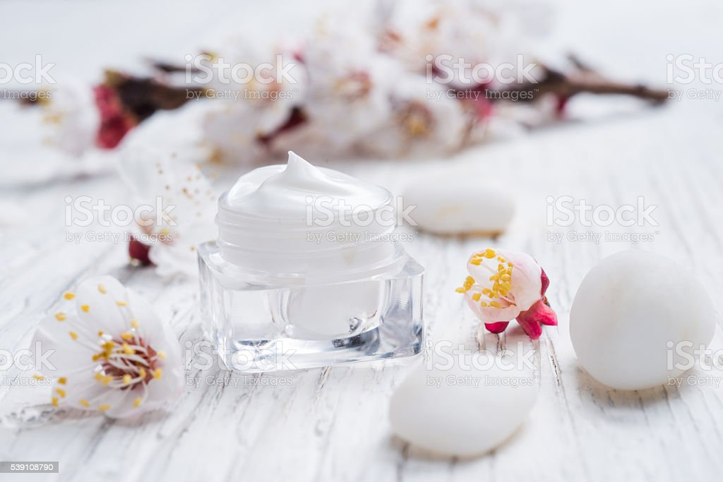 Facial cream with beauty cherry blossoms stock photo