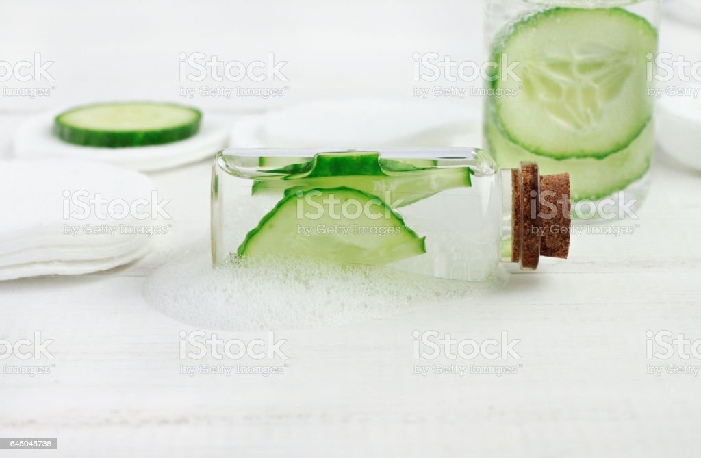 Facial cucumber lotion. Hydrating skincare gel in bottle stock photo