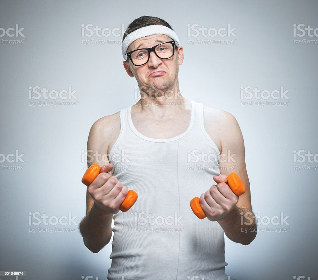 Facial expression nerd with dumbbells stock photo