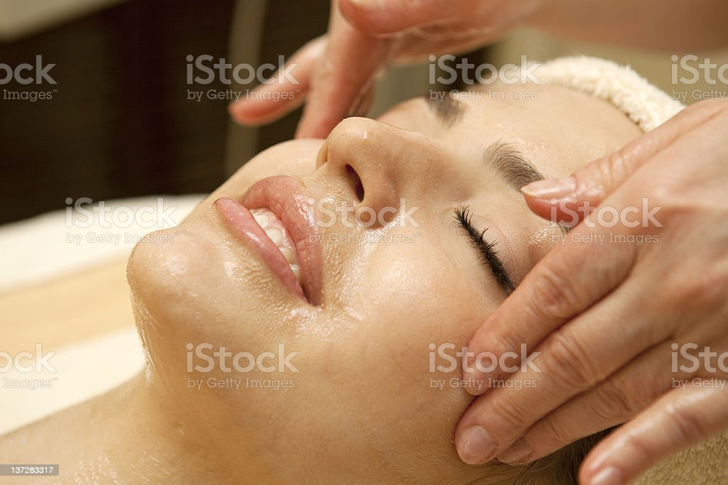 Facial massage.XXXL royalty-free stock photo