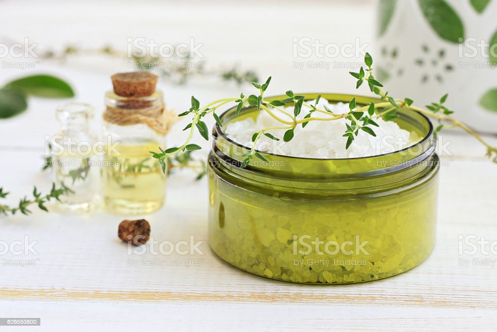 Facial scrub with salt and thyme oil. stock photo