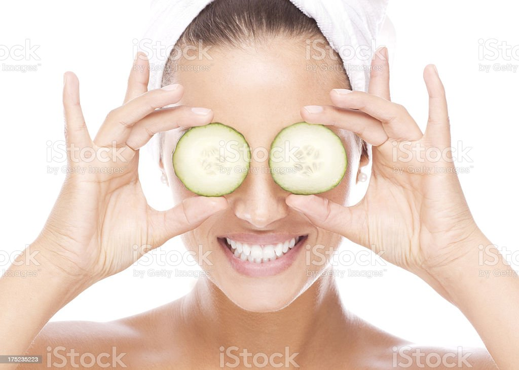 Facial skin care with cucumber stock photo