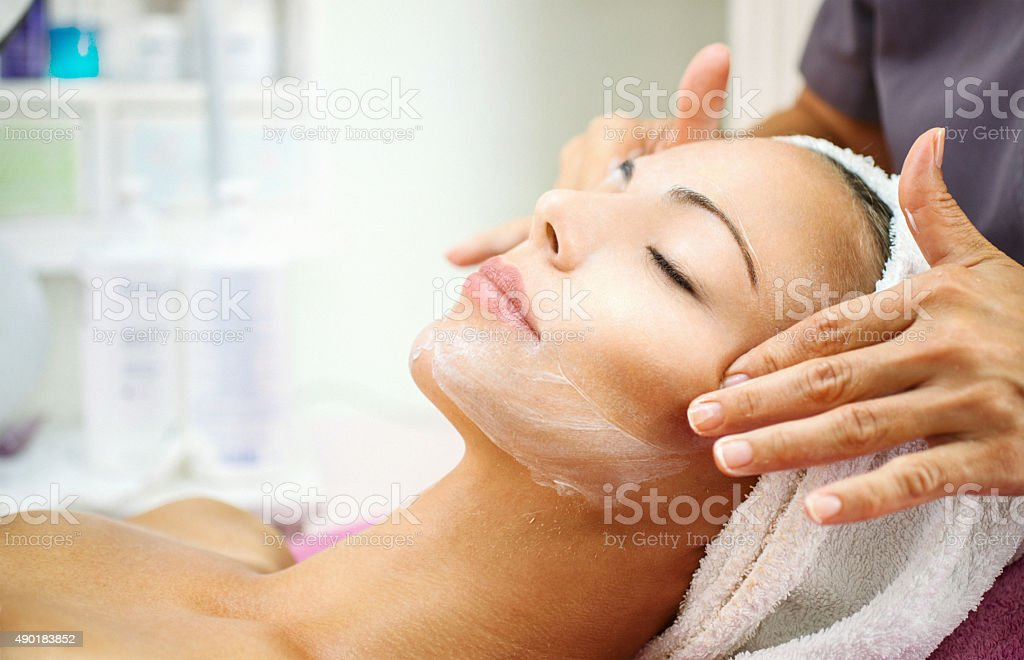 Facial treatment at beauty salon. stock photo