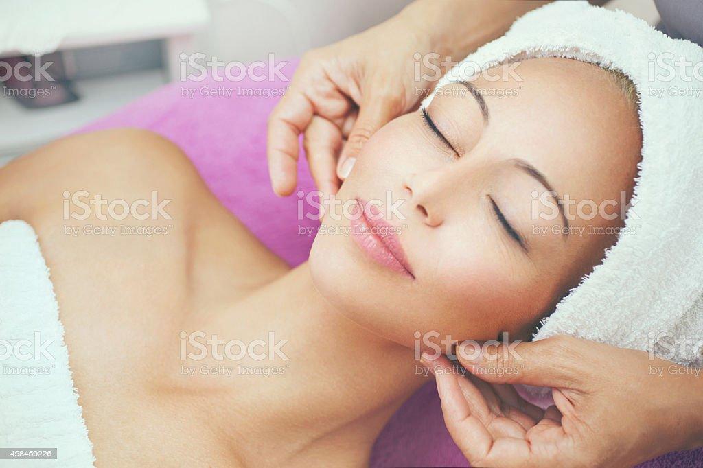 Facial treatment at beauty salon. stock photo