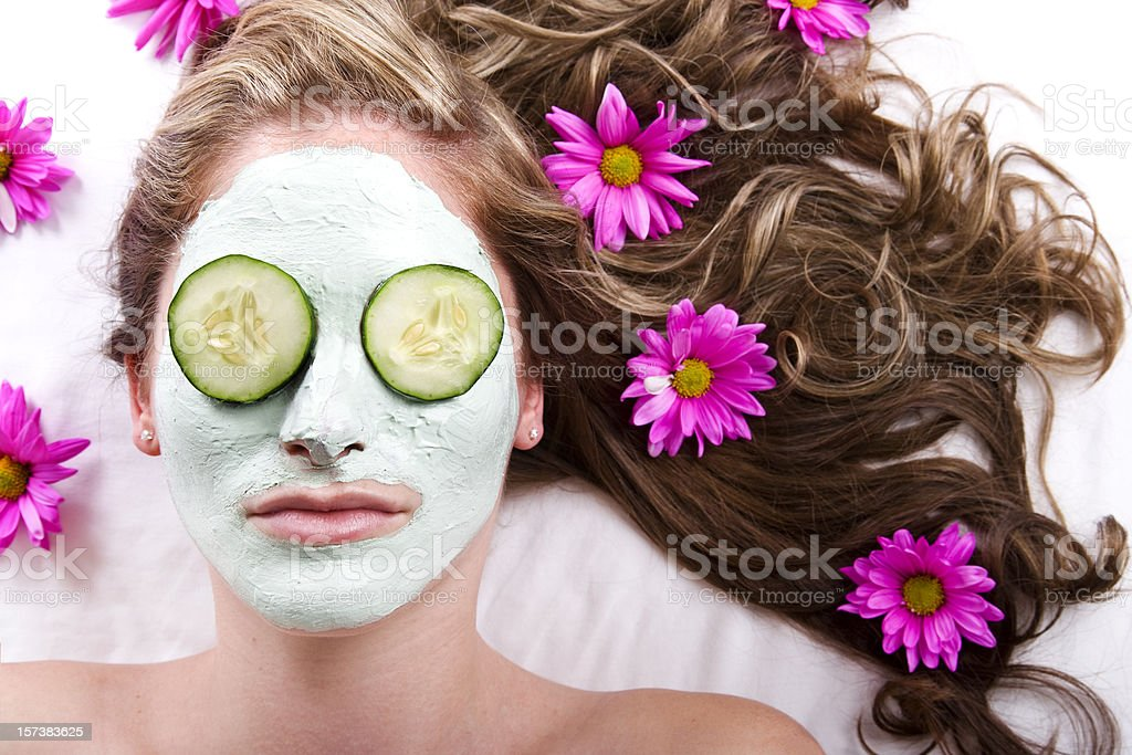 Facial with Cucumbers and Flowers royalty-free stock photo