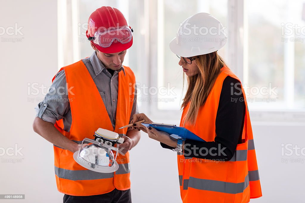 Facility maintenance team at work stock photo