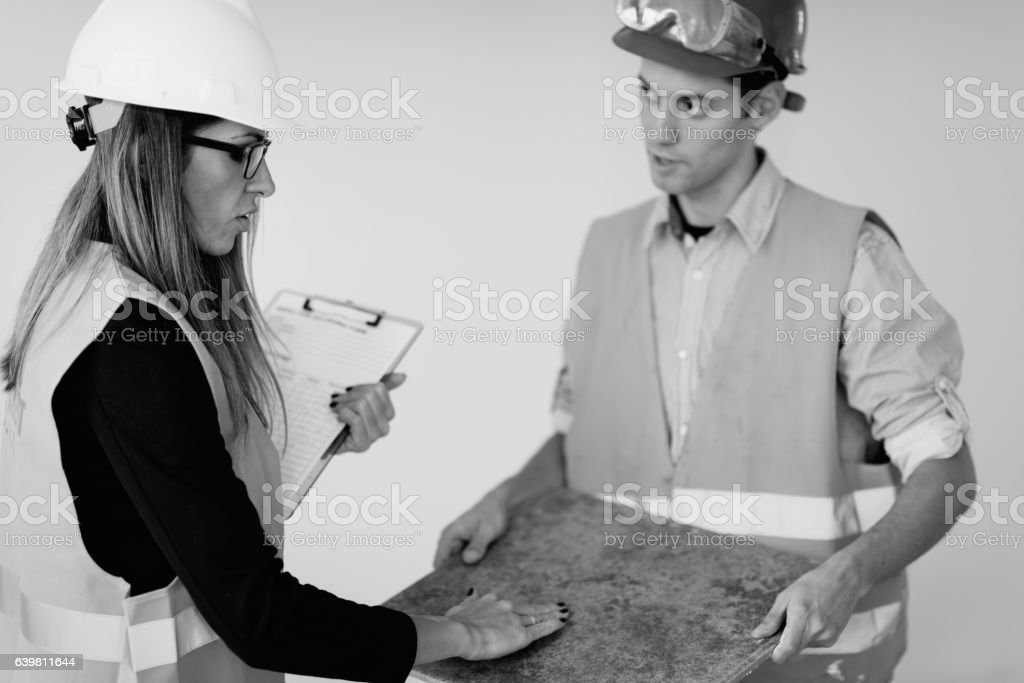 Facility maintenance technicians at work stock photo