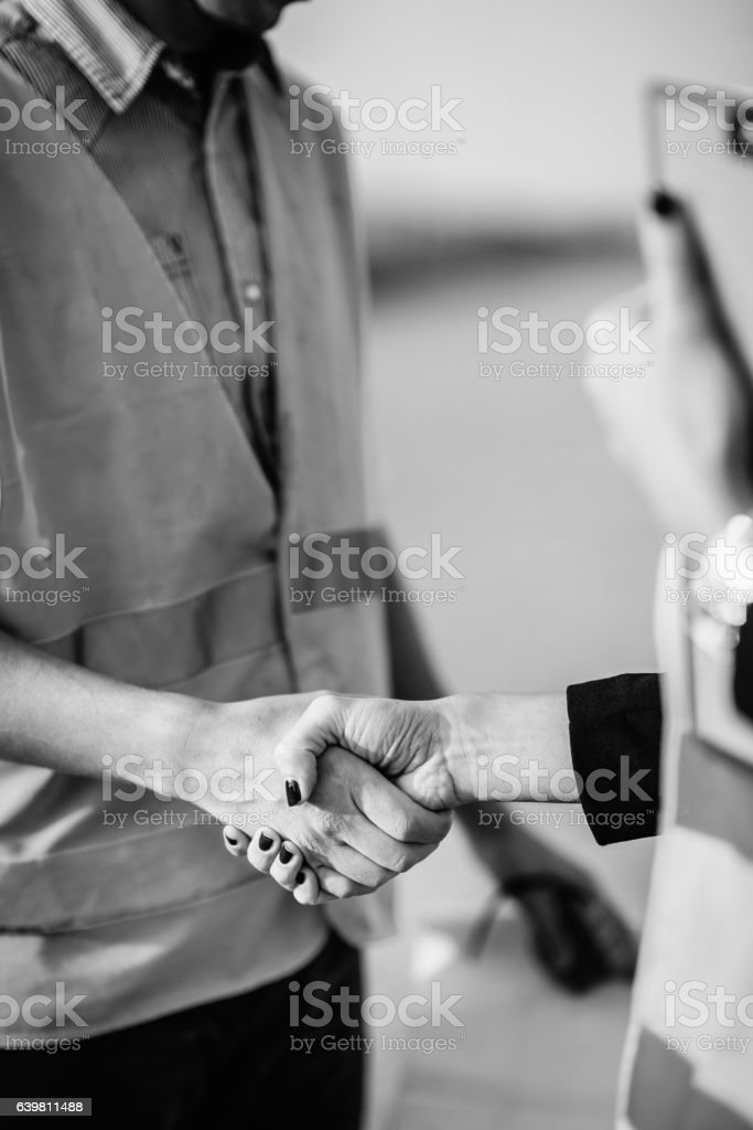 Facility management people shaking hands stock photo
