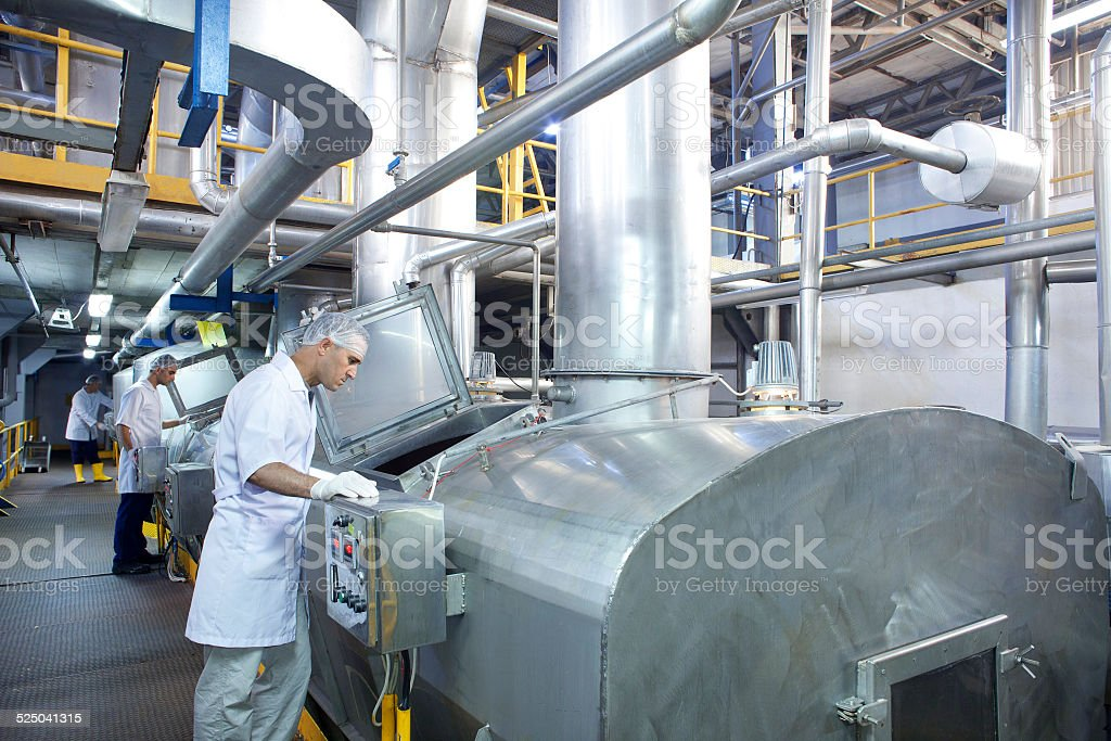 Factory and inspectors stock photo