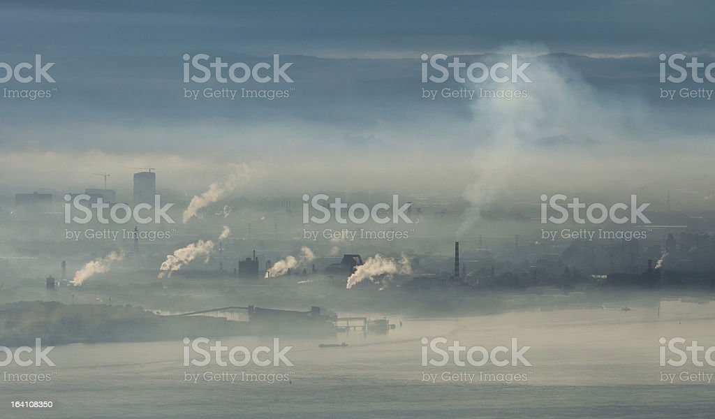 Factory area with smoke and steam royalty-free stock photo