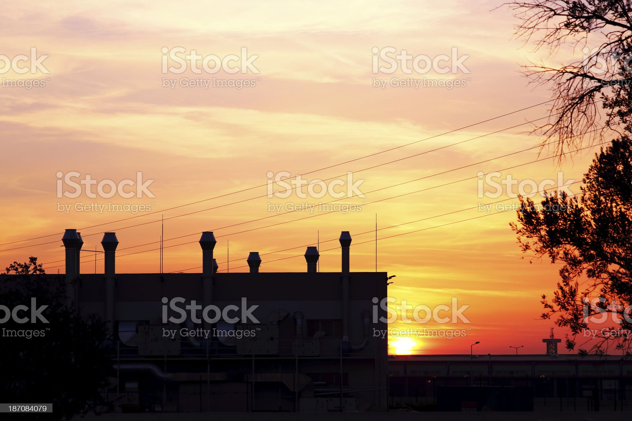 Factory at sunset royalty-free stock photo
