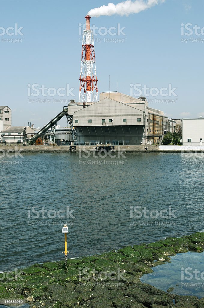 Factory building on estuary in Japan royalty-free stock photo
