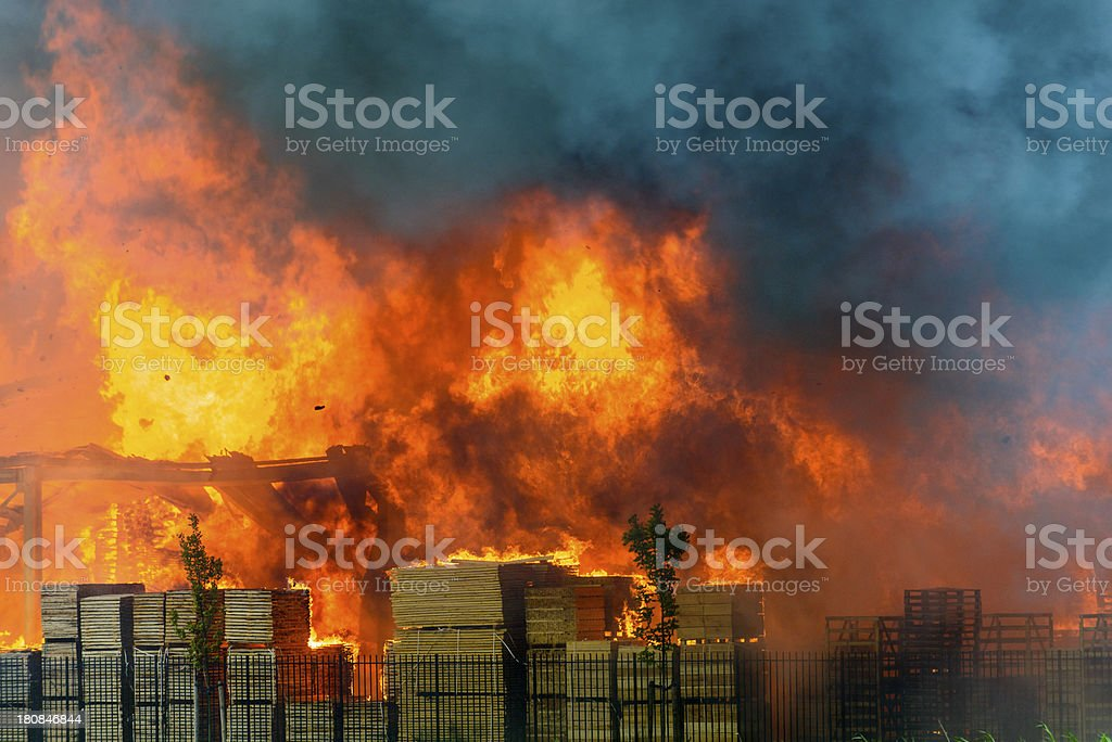 Factory burning in industrial area stock photo