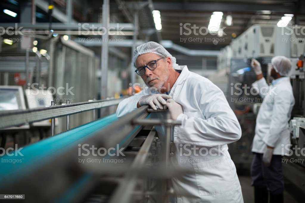 Factory engineer monitoring production line stock photo