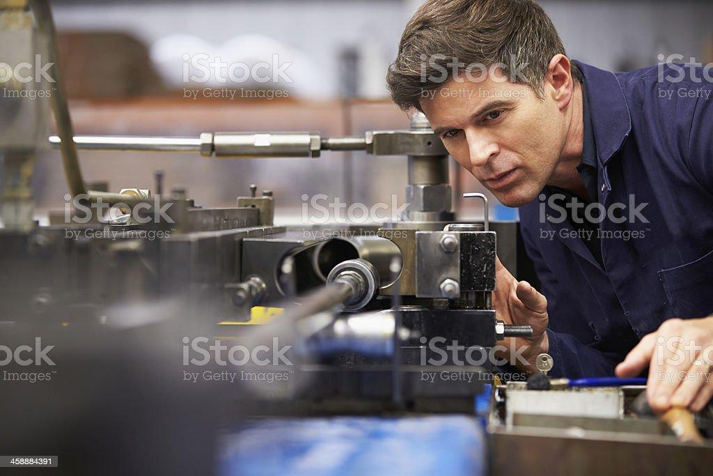 Factory Engineer Operating Hydraulic Tube Bender stock photo