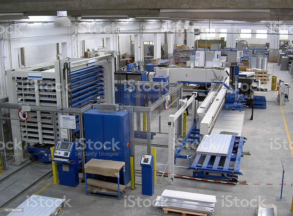 Factory floor with building machinery stock photo