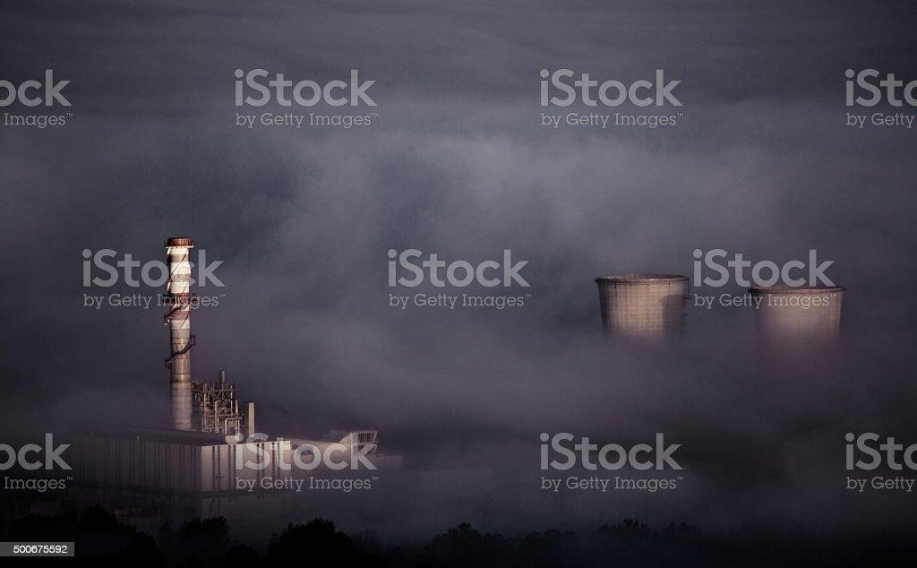 factory in smoke stock photo