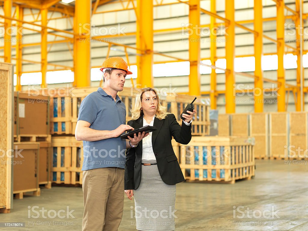 Factory Manager and Warehouse Worker royalty-free stock photo